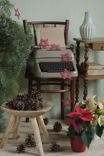 Interior Decoration For Christmas: Typewriter, Christmas Tree, Cones And Flowers
