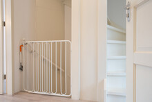 Protective White Baby Safety Stair Gate In Hallway Stairwell Modern New House, Fence For Children In Beautiful Home