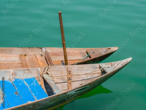 Fotografie, Obraz Pair of traditional wooden Vietnamese sampan rowboats on water