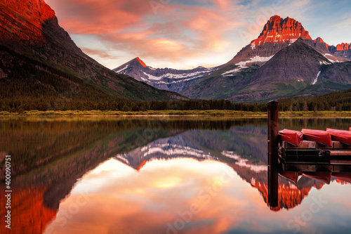 Canvas Print Alpenglow on Mount Grinnell at dawn seen at Many Glacier in Montana's Glacier Na