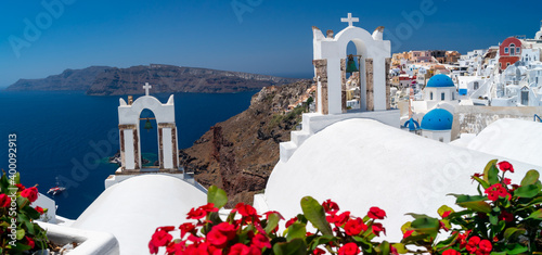 Red flowers bougainvillaea with background in Greek white ortodox church with be Tapéta, Fotótapéta