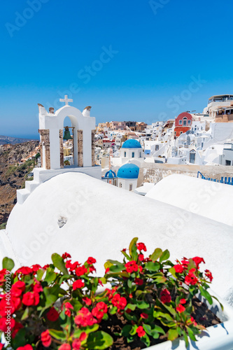 Red flowers bougainvillaea with background in Greek white orthodox church with b Fotobehang