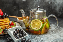 Front View Delicious Pancakes With Olives And Kettle With Tea On Light Background Fruit Food