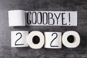 Fototapeta Koszykówka Text Goodbye 2020 made with toilet paper on grey stone background, flat lay