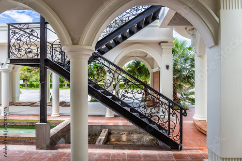 Fotografia Classic black iron staircase in a vintage style for walking up and down a European style building