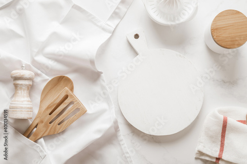 Tableau sur Toile Culinary background, kitchen utensils and apron on kitchen countertop with blank