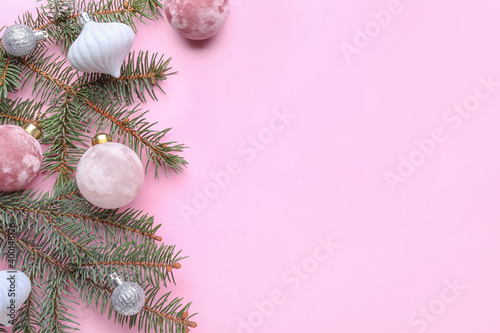Obraz Fir tree branch with beautiful Christmas balls on color background - fototapety do salonu