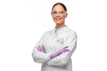 Science And Profession Concept - Happy Smiling Female Scientist In Goggles And Gloves With Nametag On Lab Coat