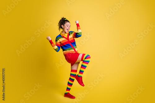 Canvas-taulu Photo of winner lady raise hands leg up best win ever wear striped sweater short