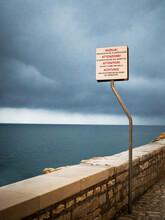 Warning Sign Of A Cliffs Edge In Rovinj Croatia