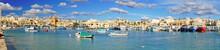 Traditional Fishing Boats In The Mediterranean Village Of Marsaxlokk, Malta