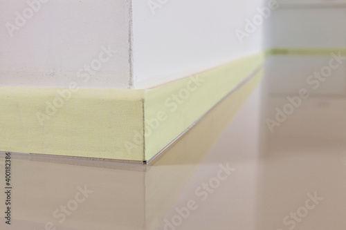 Canvas Print Close-up of a yellow masking painters tape to protect the plinth, before painting the floor or installing a synthetic cast floor