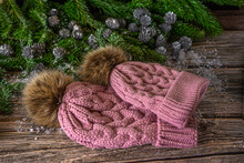 Warm Knitted Pink Hats With Pompom For Mother And Daughter. Christmas Decoration On Wooden Background.