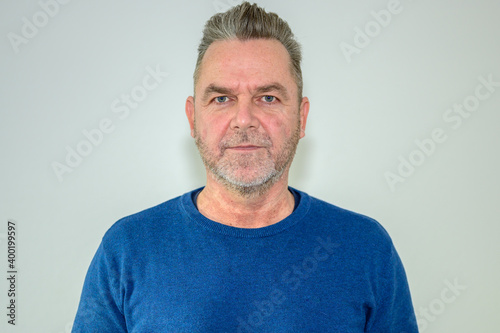 Fotografia, Obraz Unshaven middle-aged man with modern hairstyle