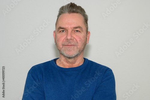 Fototapeta Unshaven middle-aged man with modern hairstyle