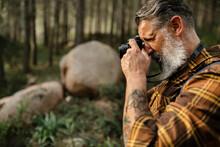 Close Up Of Caucasian Senior Man Taking Photo With Camera
