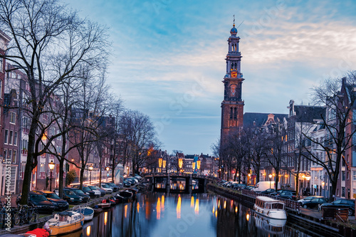Slika na platnu Amsterdam Netherlands canals with lights during evening in December during wintertime in the Netherlands Amsterdam city