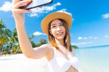 Portrait Of Asian Woman In Bikini Selfie Herself On White Beach In Thailand