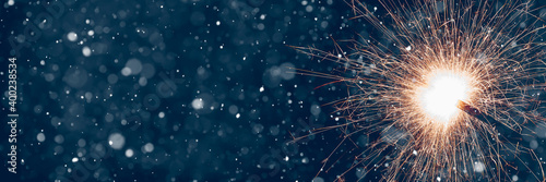 Fototapeta Burning sparklers on abstract snowy background, party concept with advertising space. 3d illustration obraz