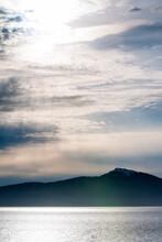 Sun Rays Peeking Through Clouds Along The Coast Of Southern Alaska