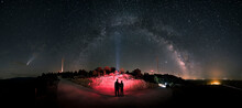 Comet Nowise. A Loving Couple Observes The Milky Way And Comet Neowise As It Orbits The Solar System. Night Landscape, A Panoramic View Of The Milky Way And Comet Nowise In July 2020.
