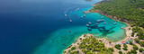 Fototapeta Kawa jest smaczna - Aerial drone ultra wide photo of exotic bay of Moni island visited by yachts and sail boats, Aegina island, Saronic gulf, Greece