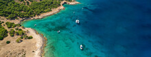 Aerial Drone Ultra Wide Photo Of Exotic Bay Of Moni Island Visited By Yachts And Sail Boats, Aegina Island, Saronic Gulf, Greece