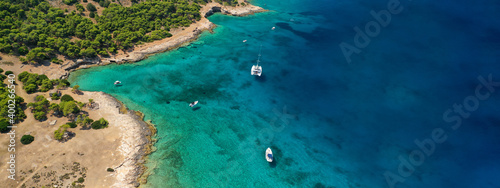 Obraz Aerial drone ultra wide photo of exotic bay of Moni island visited by yachts and sail boats, Aegina island, Saronic gulf, Greece - fototapety do salonu