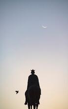 Spain, Seville, Plaza Nueva, Silhouette Of Equestrian Statue Of King Fernando III