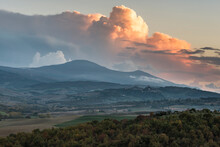 Italy, Tuscany, San Quirico D'orcia, Landscape In Evening With Flaming Clouds In Sky
