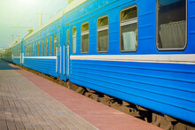 Standard Blue Railway Carriages At Station Platforms At Daytime