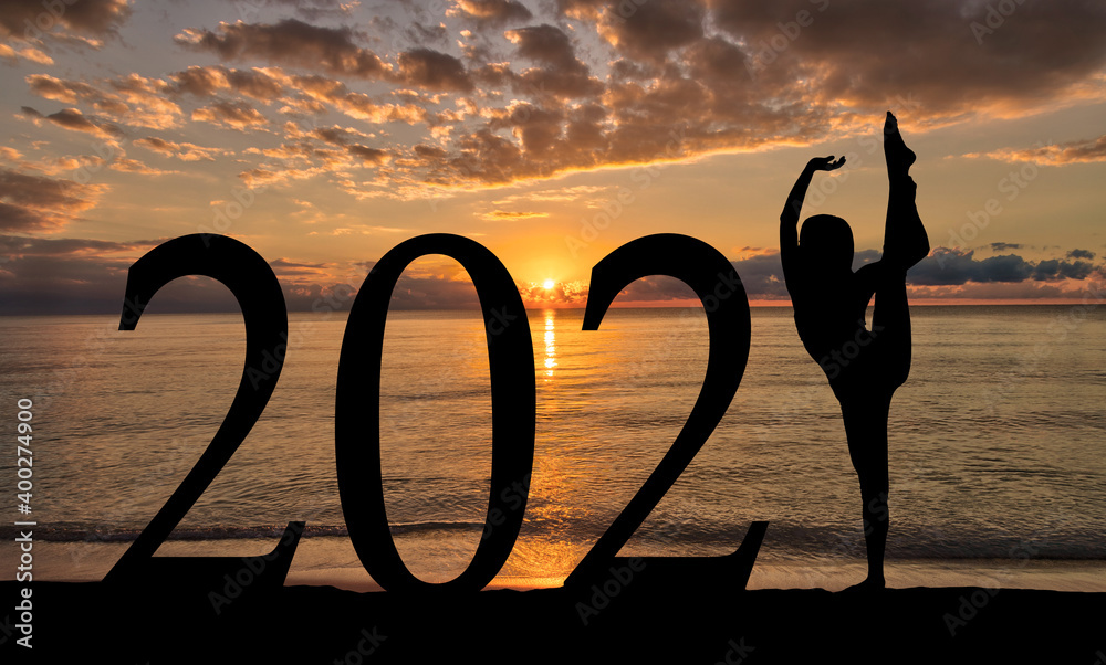 Fototapeta New Year 2021 at Beach Sunrise Silhouette of Woman Dancing