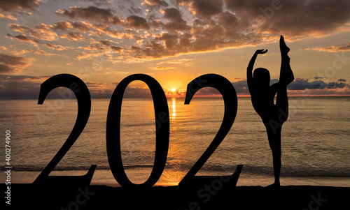 Leinwand Poster New Year 2021 at Beach Sunrise Silhouette of Woman Dancing