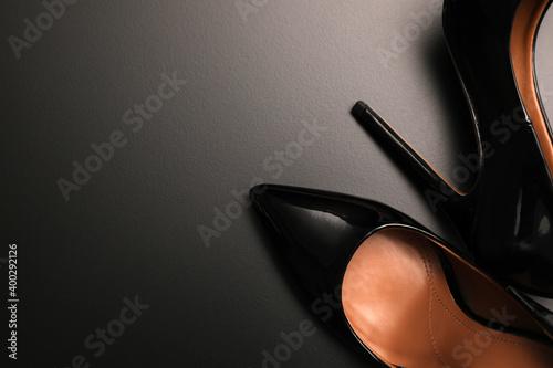 Fotografiet Beautiful high heel shoes on black background, flat lay
