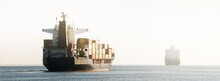 Large Cargo Container Ship Leaving The Port, Sailing In A Still Sea Water. Panoramic View. Freight Transportation, Nautical Vessel, Global Communications, Industry, Carrying, Logistics, Commerce