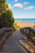 Wooden Structure Leading To The Beach. Beautiful Promenade Near The Shore. Vertical Shot.