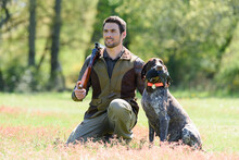 Hunter And Dog In Field
