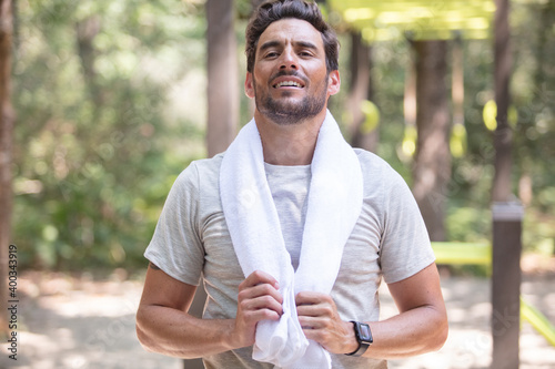 man athlete with towel and nature background
