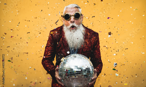 Canvas Print Crazy senior man having fun doing party during holidays time - Elderly people ce