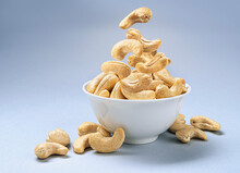Cashew Nuts Into Bowl With Copy Space