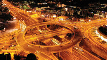 Aerial Drone Slow Shutter Night Slow Shutter Shot Of Multilevel Junction Ring Road Passing Through City Centre