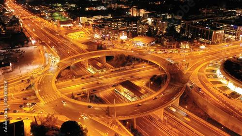 Aerial drone slow shutter night slow shutter shot of multilevel junction ring ro Fotobehang