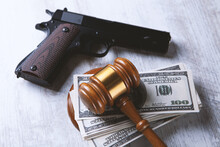 Judge's Gavel, Handcuffs, Money And A Gun