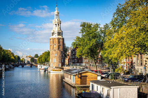 tower on a calm canal in Amsterdam Wallpaper Mural