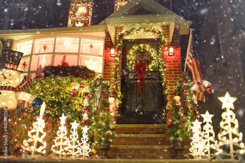 New York, USA - December 26, 2019: A street, house and porch decorated for Christmas and New Year in the Dyker Heights neighborhood Tapéta, Fotótapéta