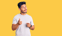 Handsome Latin American Young Man Wearing Casual Tshirt Pointing Fingers To Camera With Happy And Funny Face. Good Energy And Vibes.