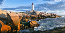 Peggy's Cove Lighthouse At Sunset With Ocean, Waves, And Rocky Shoreline