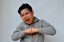 Potrait Of Asian Boy With Angry Expression