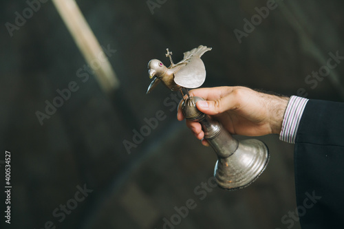Slika na platnu Armenian priest in monastery holding a bird made of silver during christening ri