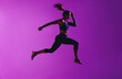 canvas print picture - Side view of fit woman running